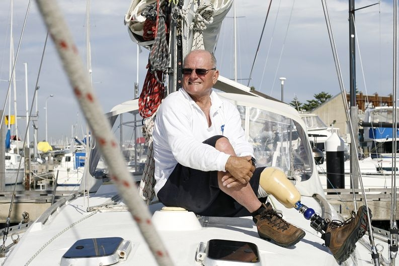 Graeme Martin gets ready to trade in his old artificial leg aboard his yacht Sand Crab's Disco . Picture: Marcus Whisson d400380