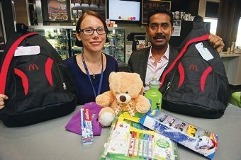 Would you like a teddy with that? WA Police's Katie Vos with Shanti Sivaraj, licensee of the McDonald's in Butler, with one of the comfort bags given to children in crisis. Picture: Emma Reeves www.communitypix.com.au d400255