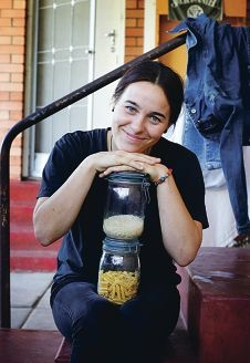 Alexandra Vaughan-Taylor (24) with foods that will be a part of her diet during her Live Below the Line experience.