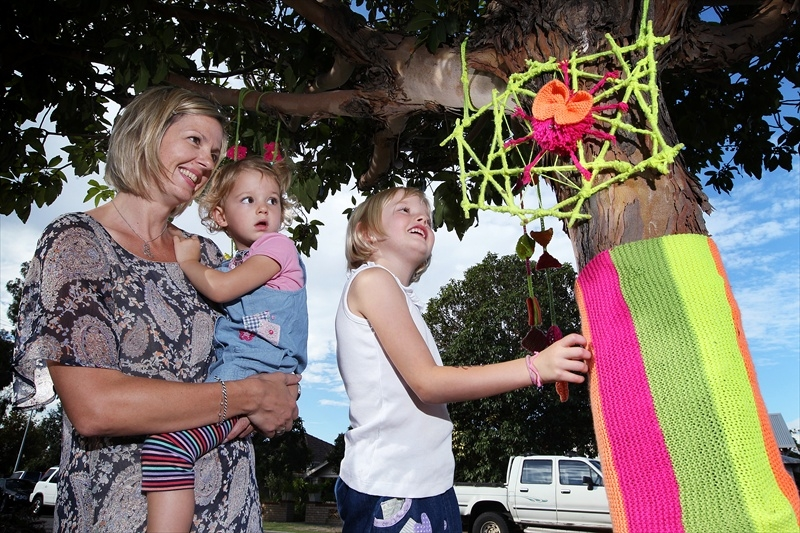 Rhona Smith with daughters Ella and Jasmine with more of the fairies' work. Picture: Dominique Menegaldo www.communitypix.com.au d400298