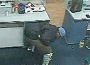 Police are seeking help to identify this man who punched a woman during a robbery at in Mindarie last month.