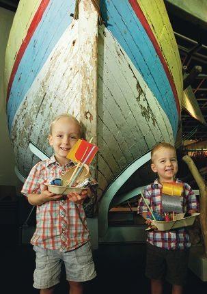 Brothers Ewan (4) and Louis (2) with their boats.