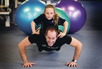 Fitness instructor Matt Harris exercising with his daughter Taya (8).