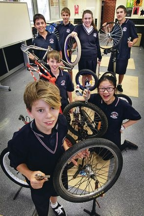 Clockwise from front: Brodie Grant, Oscar Nielson, Daniel Matteo, Aron Smith Gemma Parsons, Michael Nicoli and Kelly Chen with their bicycles.