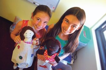 Chloe and Lili Walker with some of the Communicare dolls donated to Joondalup Health Campus recently.