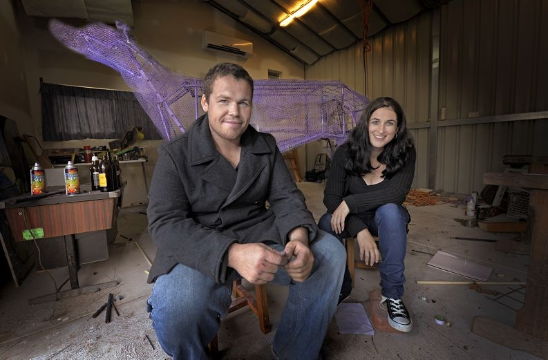 Husband and wife art team Dan and Steph Moses, of Safety Bay, with their king size greyhound sculpture.