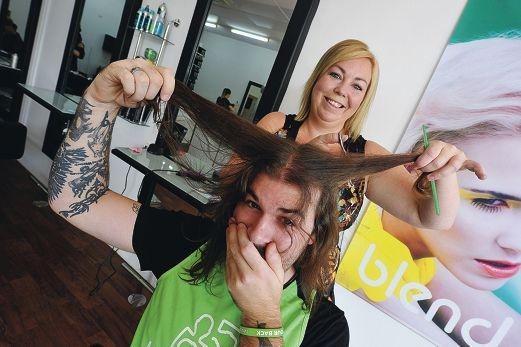 Catherine De Pedro prepares to give Rob Walker the chop. Picture: Jon Hewson www.communitypix.com.au d400715