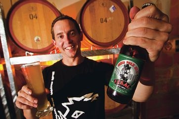 Will Irving from Feral Brewing with a glass of Watermelon Warhead beer and the big winner, Hop Hog.