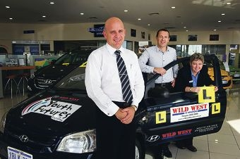 Hyundai dealer principal Craig Tickner, Youth Futures CEO Mark Waite and Balga SHS acting principal Melissa Gillett with the donated car.Picture: Emma Reeves www.communitypix.com.au d400586