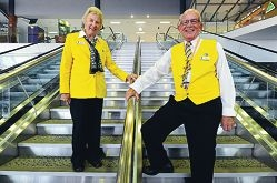 Perth International Airport Gold Coat volunteers Bernice Campbell and Paul Headley. Picture: Marcus Whisson d400604