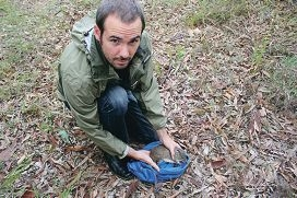 Conservation co-ordinator Craig Olegnik prepares to release a quenda.
