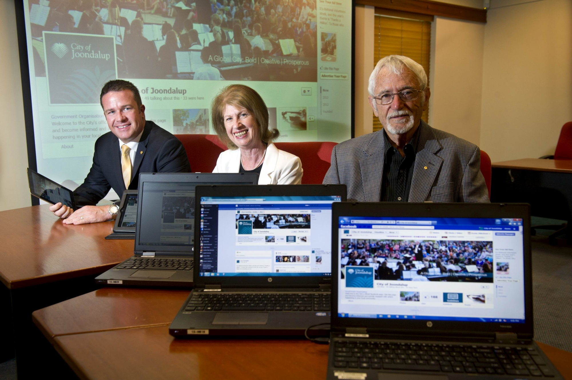Wanneroo Times cofounders Bernice and Bill Marwick (right) join Mayor Troy Pickard for the launch of the City of Joondalup Facebook page. Picture: Emma Reeves d400940