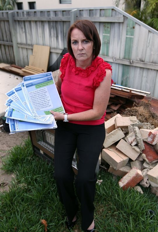 Anna Murphy stands amid the debris left by her first builder.