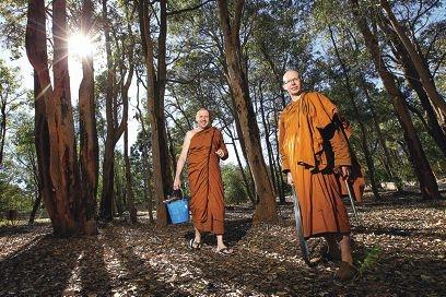 Buddhist monks Venerable Mudu with Venerable Buddharakkhita tend to the land.