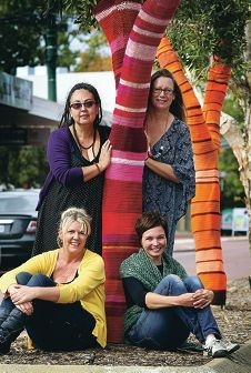 Yarn bombers Lani Retter, Deb McMahon, Suz Clark and Nataasha Lethbridge with some of their creations.