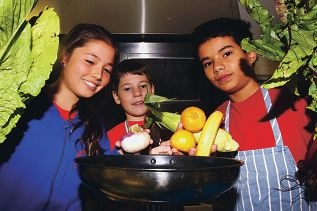Jessica Burmester, Taron Davies and Ruben Woodward enjoy cooking with fresh ingredients. Picture: Robin Kornet www.communitypix.com.au d400885