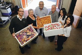 Perth Inflight Catering staff, from left, Salim, Ismail, Nadia and Carla Hazife with Manna Industries founders Bev and John Lowe and some of the donated food [NAMES OK]