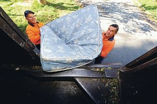 Verge collection contractors Brad Fraser and Bob Hobbs collect a mattress for recycling. Picture: Marcus Whisson d401557