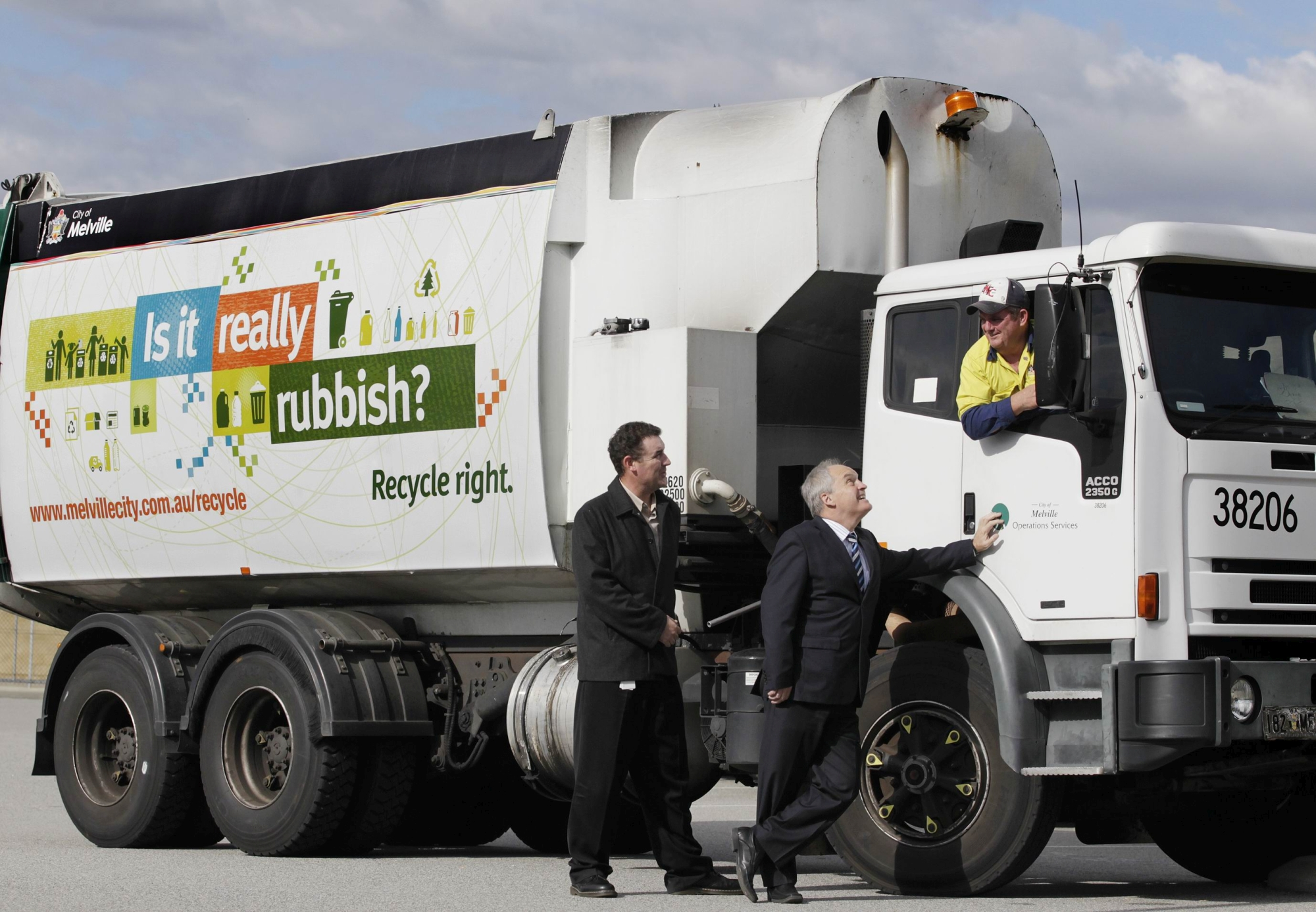 Brett McGinnes (waste business manager) looks on as Melville Mayor Russell Aubrey chats with driver Bernie Hayes. Picture: Martin Kennealey d401504