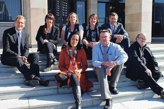 Member for the Agricultural Region Darren West (left) with a group of petitioners on the steps of Parliament House last Friday.