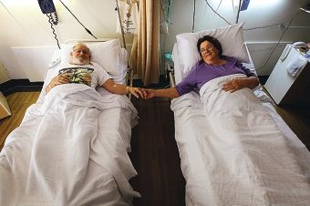 Husband and wife Arthur and Beverley McCusker are recovering in hospital together after undergoing the same back surgery on the same day. Picture: Andrew Ritchie d401947