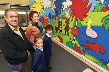 Library builder John Carter and daughter Sally, mural artist Ofira Waldispuhl and student Khaleb Hillman. Picture: Bruce Hunt www.communitypix.com.au d401630