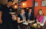 Himali Gurka restaurant owner Krishnaman Shrestha with fundraisers Amy Wilson-Chapman, Ronald Mizen and Casey Lewis.