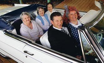 Straight out of American Hot Wax: Lauren Ruthsaltz,Susan Bowman and Tana Walker with Pierce Bradley and day centre co-ordinator Jill Howard channel 1950s crusing style. Picture: Martin Kennealey www.communitypix.com.au d402021