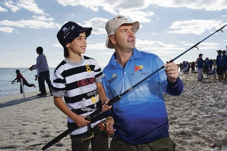 Anthony Nedelkos (9) and Craig Wells fishing at the Northern Beach at Hillarys Boat Harbour.