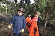 Year 5 student Joshua Bell with teacher's assistant Gill Grinfelds picking up litter. d401834