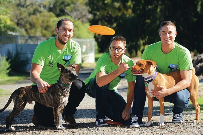 BHP workers John Maravillas with Finn, James Pregnell and Jeremy Thornett with Banksia. Picture: Marcus Whisson d401857