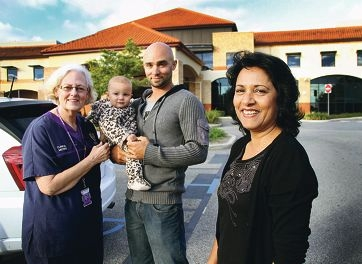 Happy reunion for midwife Judith Whitaker, Andrew and Hunter Johnson and Gloria Oliver.d401804