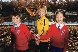 From left: Sacred Heart Primary School student Luca Bongiovanni (10), Highgate Primary School student Wylie Vennwoods (12) and Alana Lim (10) with the Peace Run torch [NAMES OK]