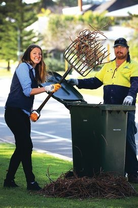 Cottesloe sustainbaility officer Nikki Pursell and Jade Muir... a green waste bin would mean council staff would no longer need to rake pine needles. Picture: Andrew Ritchie d402745