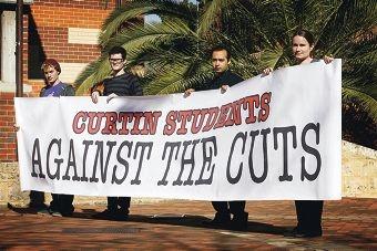 Sam Cavallaro, Kyle Hardy, Amir Nourani and Jess McLeod protest the PM's arrival in Fremantle. Picture: Marie Nirme www.communitypix.com.au d402647