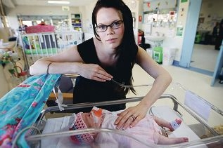 Krista Richards with her baby Olivia, who was born prematurely at 26 weeks.