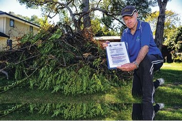 Balga Action Group president Alan Stafford with a verge clean-up notice. Picture: Marcus Whisson www.communitypix.com.au d402609