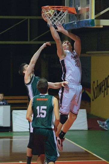 Redbacks player Justin Brown puts away a basket.