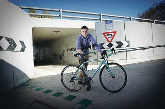 Travis Deane is urging the State Government to fix a section of the bike path where he was recently injured in a collision with another cyclist. Picture: Andrew Ritchie d403022