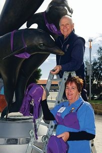 Robin Russell and Heather Gale (past and current Rotary club presidents respectively) dress the dolphins for the occasion. Picture: Emma Reeves d402701