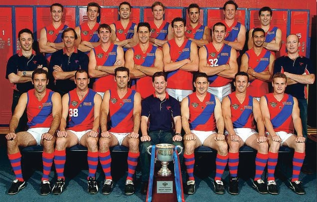 The Falcons' 2003 premiership team had plenty to smile about when they posed for this group photograph.