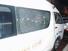The smashed windows of the taxi.