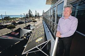 Paul Squires overlooks the esplanade at his establishment.