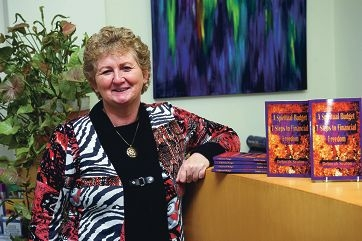 Debbie Seaton with her first book. Picture: Emma Reeves www.communitypix.com.au d403003