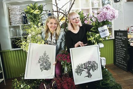 Emma Dziadulewicz and Alicia Lowe with their work. Picture: Louise White www.communitypix.com.au d403006