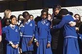 Dorine's classmates Godwin Imo, Kelly Chapman and Sona Shabu hold a picture of him.