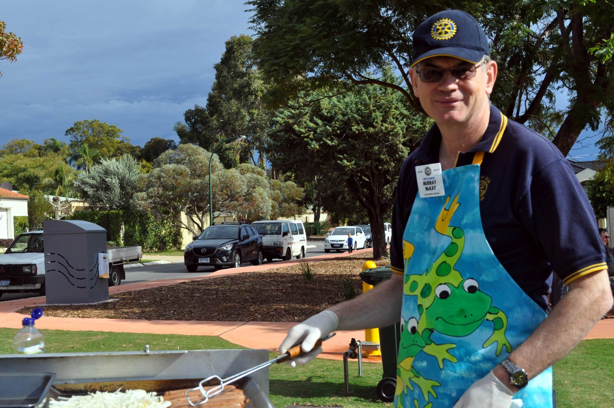 Applecross Rotary Club member Murray McKay cooking the barbecue.