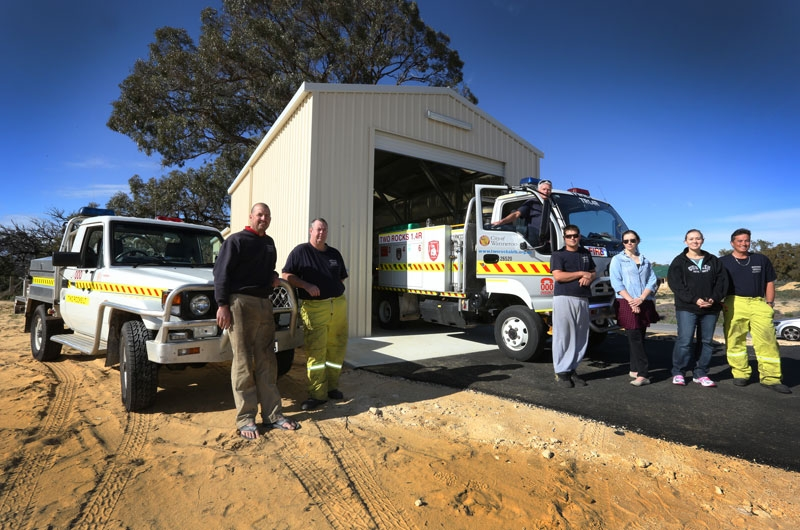 Captain Jeff Hord and Lieutenant Adrian Stoffels with volunteers at the new fire station in Two Rocks. Picture: Matt Jelonek www.communitypix.com.au d403222