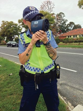 First Class Constable Fi Boucher with a laser camera.