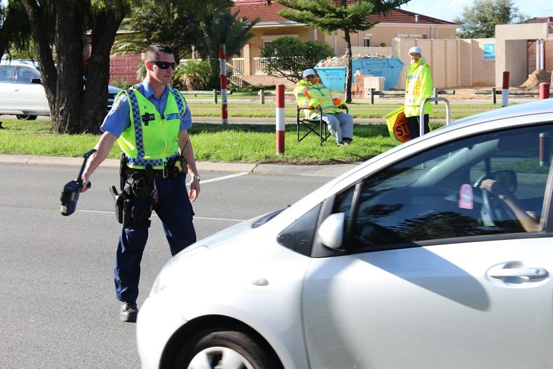 Constable Dan Barlow pulls over a motorist in the Read Street school zone on Tuesday.